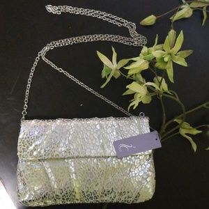 Gorgeous silver foldover clutch with a chain strap